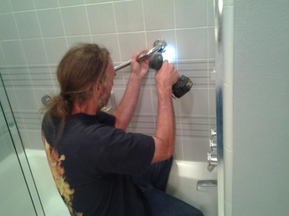 Fastening the grab bar through tile